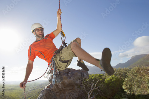 Male rock climber abseiling