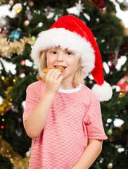 Santas helper eating gingerbread