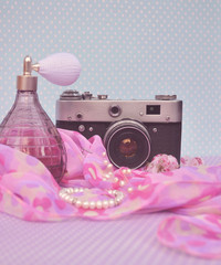 Old vintage camera with parfume
