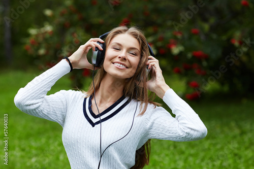 portrait of beautiful woman enjoing the music outdoors