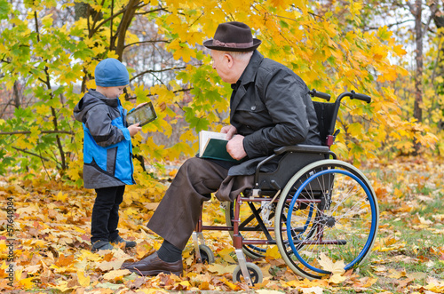 Young boy with his disabled grandfather