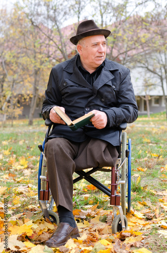 Handicapped elderly man in a wheelchair