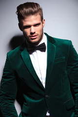 happy young man wearing a green velvet suit