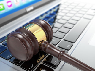 Online auction. Gavel on laptop. 3d