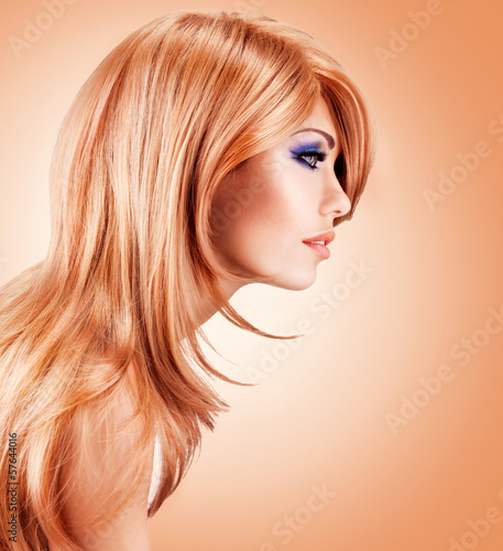 Profile portrait  of  beautiful pretty woman with long red hairs