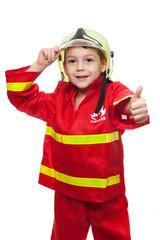 Kind als Feuerwehrmann mit Daumen nach oben