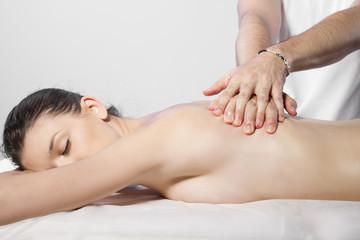 Beautiful brunette woman getting a massage