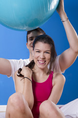 portrait of a young pretty couple, fitness indoor