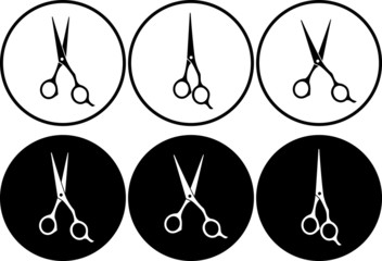 set of professional scissors in round frame