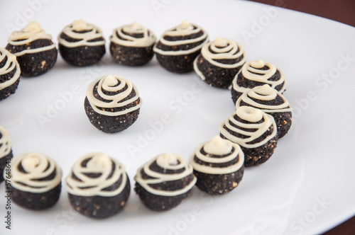 Poppy seed dessert balls with melted white chocolate on top