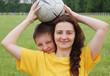 Happy family with football
