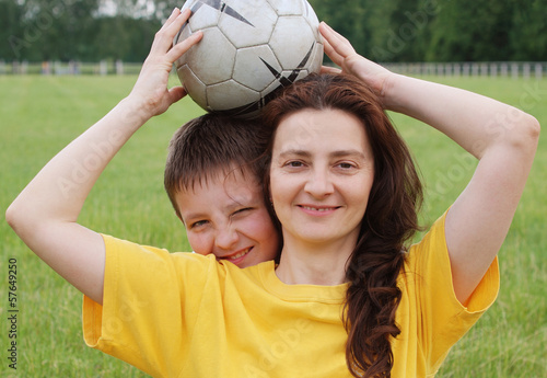 Happy family with football