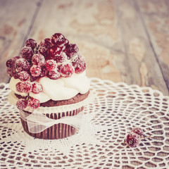 Vintage chocolate cupcake with sugared redcurrant