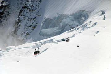 Hoist boxes against the white glacier, Chamonix