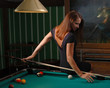 Girl playing billiards