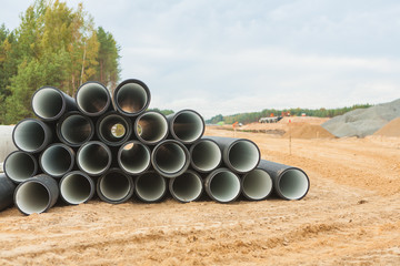 stack of big pipes on construction place