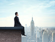 businessman sitting on roof