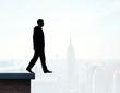 businessman walking on roof