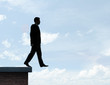 businessman walking on roof