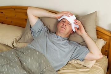 Sick Man Treating Fever