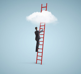 businessman on ladder