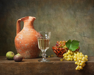 Still life with white wine and grapes