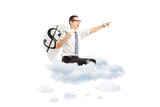 Young businessman with a money bag flying on clouds
