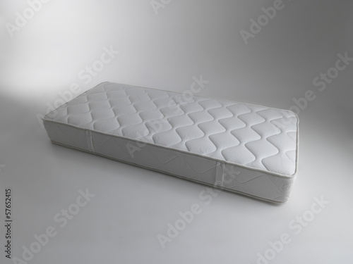 Staande foto Athene single mattress isolated on almost white background