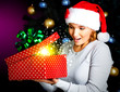 Happy amazemant woman opens the box with gifts on christmas