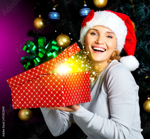 Happy laughing woman  holds the christmas box with gifts