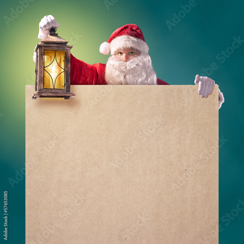 Santa Claus with a lantern and a poster