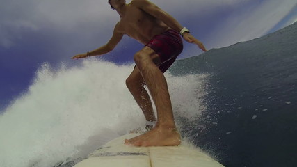POV Surfer Riding Blue Wave