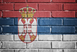 Serbia flag on a textured brick wall