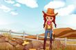 A pretty cowgirl near the rocks