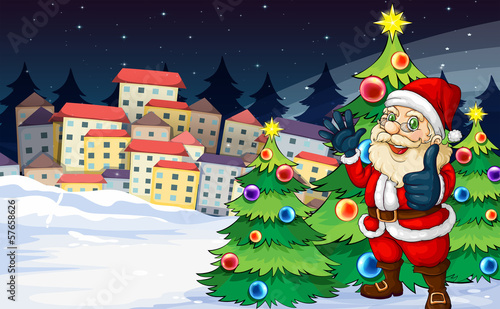 Santa Claus standing beside the Christmas trees near the village
