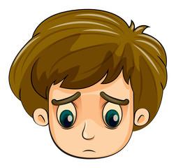 A head of a sad young boy