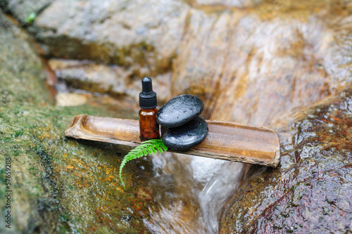 Essence oil and zen stone in spa concept