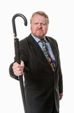 Angry businessman shakes umbrella - on white