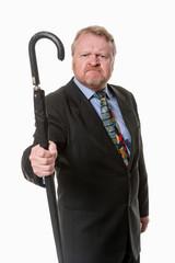 Angry businessman shakes umbrella - on white