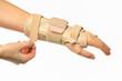 hand with a wrist brace - 57660422
