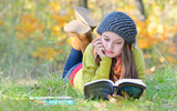 beautiful girl reading a book outdoor