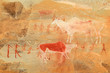 Bushmen rock painting depicting antelopes and human figures