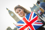 Young Woman Holding Union Jack in front of Big Ben
