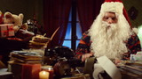 Santa Claus looking at receipts and bills