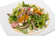 Warm salad with beef tongue, with quail eggs