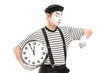 Mime artist holding a clock and checking the time