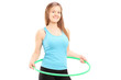 Young female athlete exercising with a hula-hoop