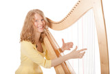 girl in yellow playing the harp