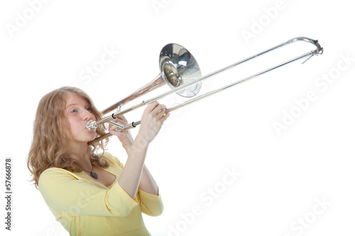 young woman in yellow with trombone
