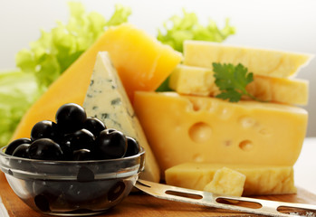 still life with cheese and olives